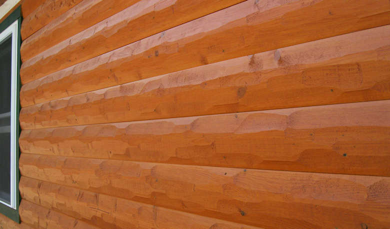 HEWN textured log siding home