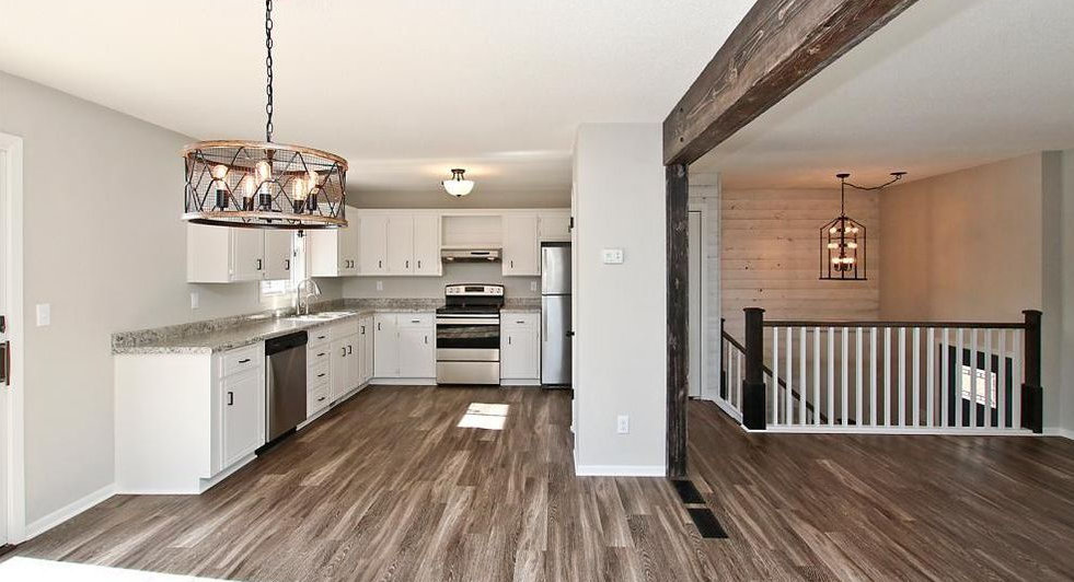 Remodeled Home with 1x6 T&G Pine Paneling Stained Whitewash plus TIMBER Beam accents