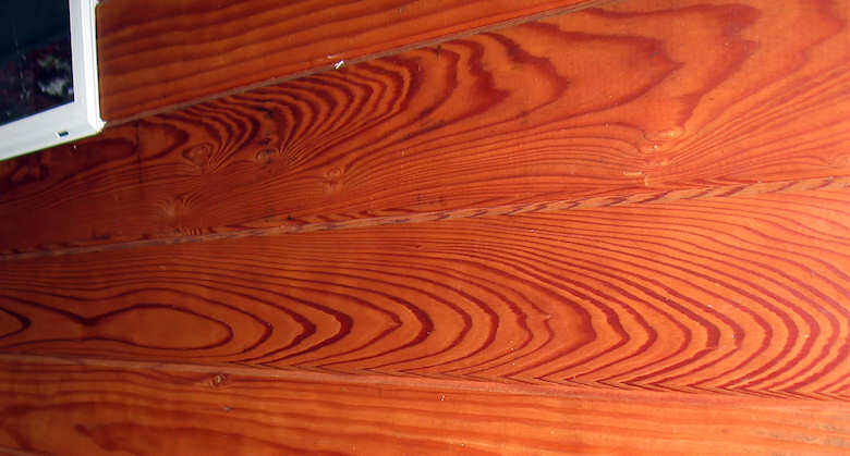 redwood siding CAH flat grain stained